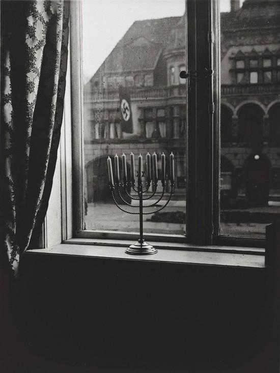 a_menorah_defies_the_nazi_flag___1931